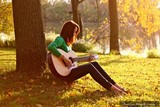 Avatar_profile_rocking-girl-playing-guitar-sunset-forest-tress